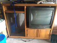 gray CRT TV with brown wooden TV hutch 73 mi