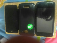 two black android smartphone with Jio case