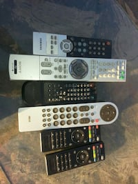 four black and gray remote controls Las Vegas, 89104