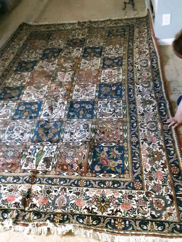 brown, white, and green floral area rug
