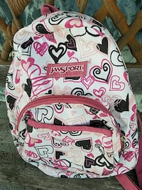white, red, and black hearts print Jansport backpack