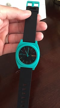 Nixon Black and Teal Wrist Watch 51 km