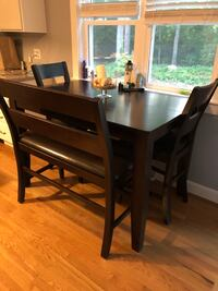 High top dinning room table comes with four chairs and a bench as well as a additional leaf to extend table  403 mi