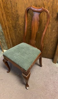 2 wooden chairs with cushion