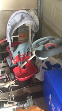 toddler's red and gray trike Lincoln, L0R