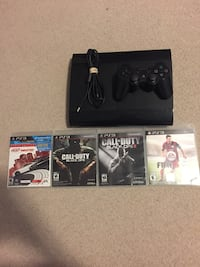Black sony ps3 console with game cases Kitchener, N2N 3R8