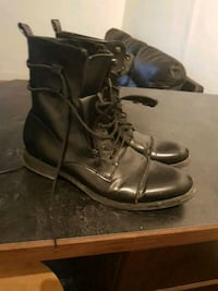 pair of black leather cap-toe combat boots Winnipeg, R3B 1Z6