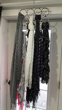 Assorted scarves and scarf hanger. Most brand new  Tay, L0K