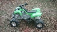 toddler's green and gray Kawasaki ride-on ATV