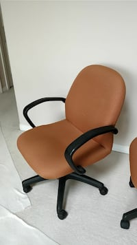 Orange-brown rolling arm chairs