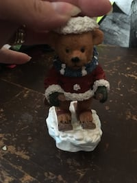 bear wearing coat and scarf figurine