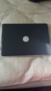 Black Dell Inspiron with charger