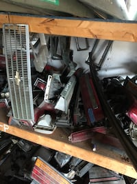 Gray chevrolet grille and assorted car part lot