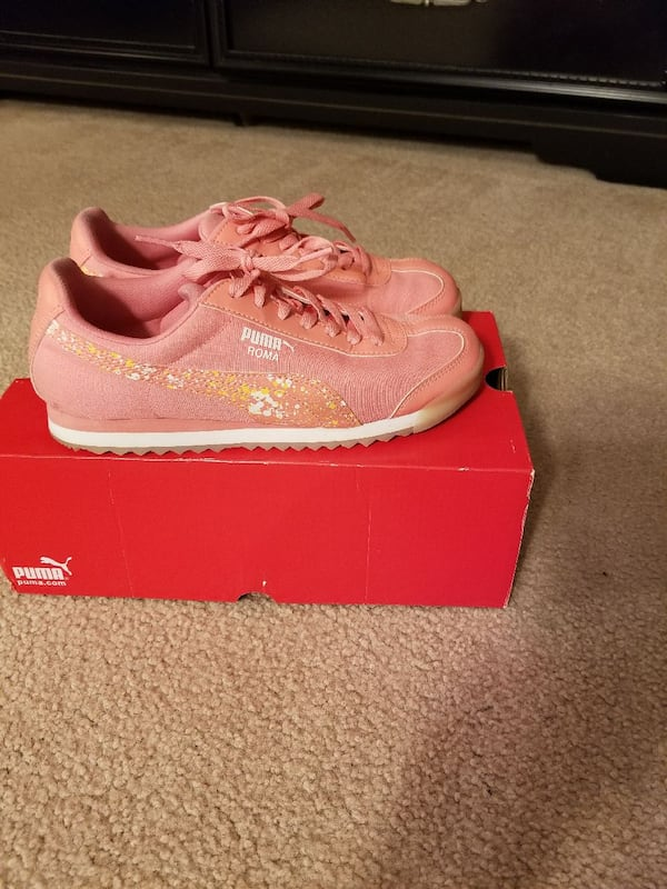 Used pair of pink-and-white PUMA Roma low-top shoes wit for ...