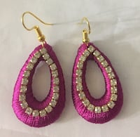 pair of pink-and-silver colored earrings