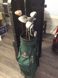 Golf clubs, bag and travel case