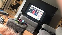 black flat screen TV with black wooden TV stand Herndon, 20170