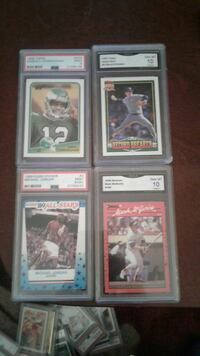 four assorted baseball trading cards