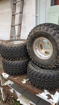 four gray vehicle wheels with tires 458 mi