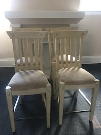 two brown wooden chairs with white pads Cleveland, 44108
