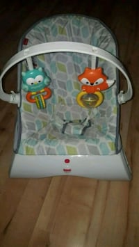 baby's white and blue bouncer Fisher price