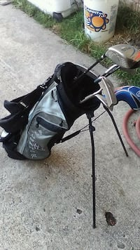 black and gray golf bag with golf clubs Houston