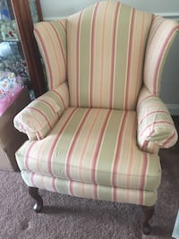 pink and white striped fabric sofa chair