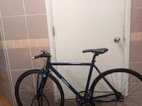 black and blue road bike Tin Yuet Stop
