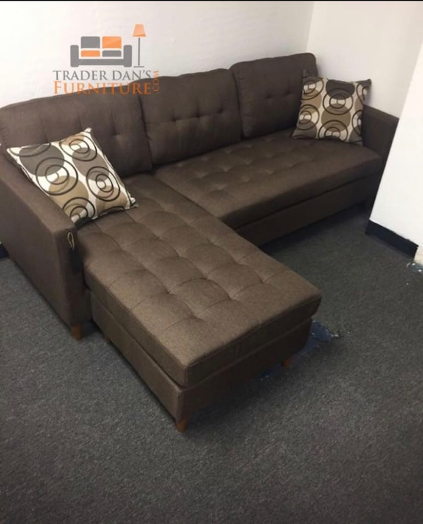 Brand new linen sectional sofa with two accent pillows
