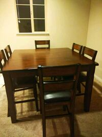 Rectangular brown wooden table with six chairs din Irvine, 92620
