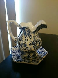 white and black floral ceramic pitcher with plate