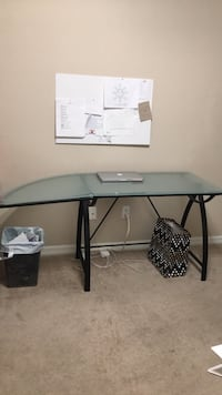 black metal base glass top table