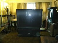 black flat screen TV with brown wooden TV stand Norfolk