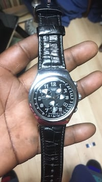 Swatch brand watch with leather strap  Kingston, K7M 5T7