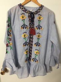 Brand new blue yellow and black with floral embroidered long sleeve shirt (size: medium) Hampstead, H3X 1L8