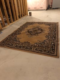 Brown and black floral area rug size 62 inches by 89 inches London, N6B 0A5