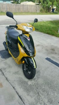 yellow and black motor scooter 895 mi