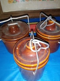 three brown ceramic canister set