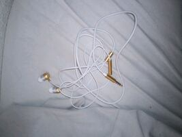 White and gold earphones