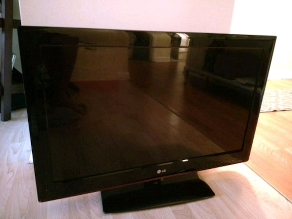 black LG flat screen TV