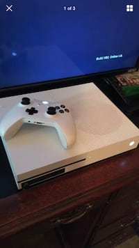 white Xbox One console 2tb with controllers and games
