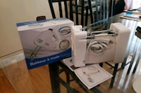white and blue electric sewing machine Toronto, M3K 1S9