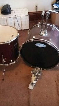 black and maroon tom tom and bass drum