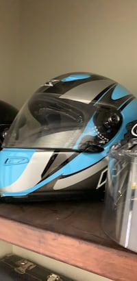 Blue and black motocross helmet with built in fans