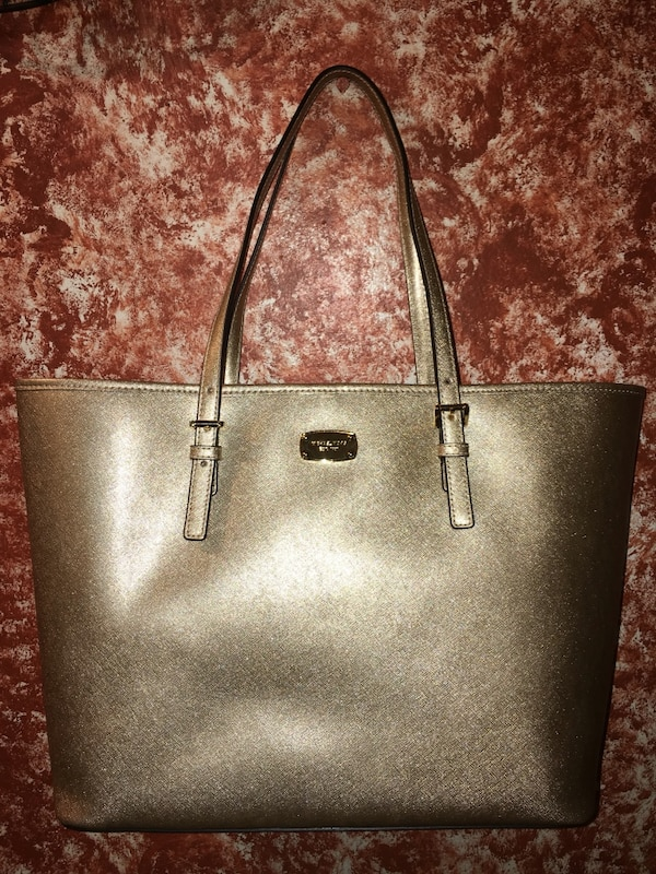 00d5abc81ec3d7 Used Michael Kors Jet Set Pale Gold Leather Large Carryall Tote Purse for  sale in New York - letgo