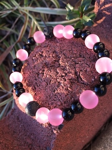 black and pink beaded bracelet