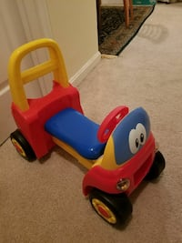 toddler's red and blue ride-on vehicle
