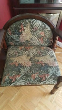 blue, red, and white floral fabric sofa chair Charleston