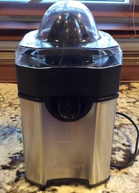 black and stainless Cuisinart plug-in citrus extractor