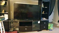 black flat screen TV with brown wooden TV stand Scottdale, 30079